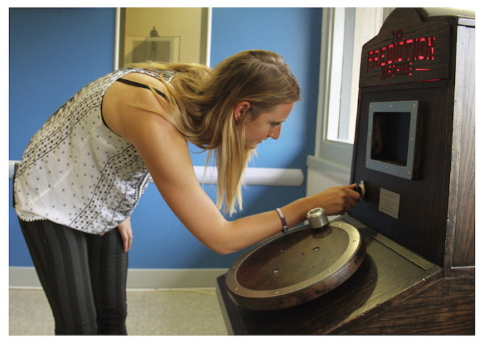 a woman turning the age dial on The Prediction Machine