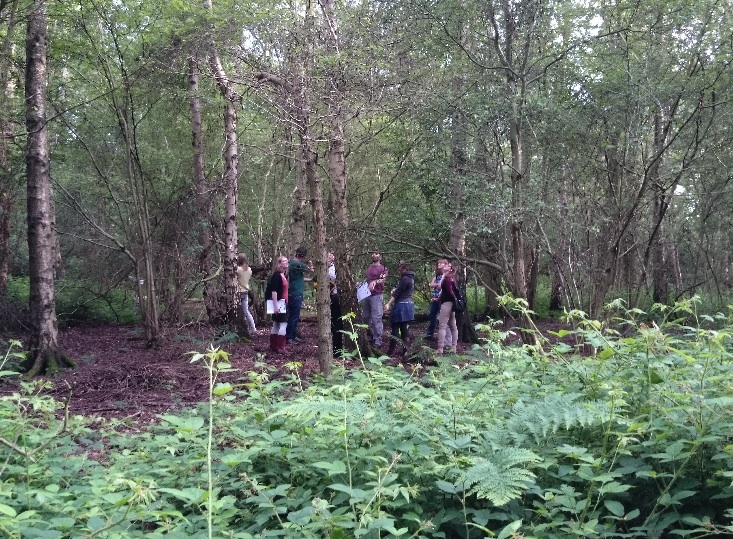 the group standing in Holywell Park, a predominantly Ash Forest on Loughborough University's campus